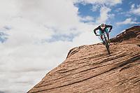 Dane Cronin mountain biking the Slickrock Trail in the Sand Flats Recreation Area, Moab, Utah.