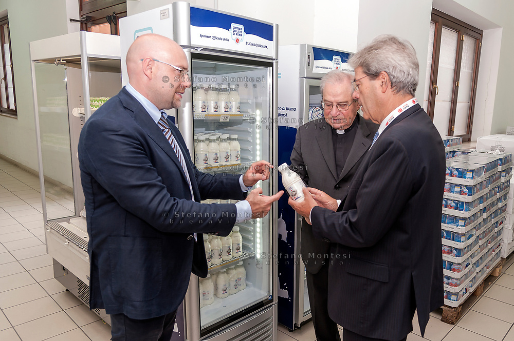 ROME, ITALY - SEPTEMBER 01:  The director of Caritas Rome, Msgr. Enrico Feroci, Italian PM Paolo Gentiloni, Simone Iannone General Secretary of Caritas of Rome during visit the Citadel of the Charity of the Diocesan Caritas of Rome on September 1, 2017 in Rome, Italy. Italian PM Paolo Gentiloni visited the Caritas to express the gratitude of all Italians to the world of volunteering, to those who work in favour of solidarity.
