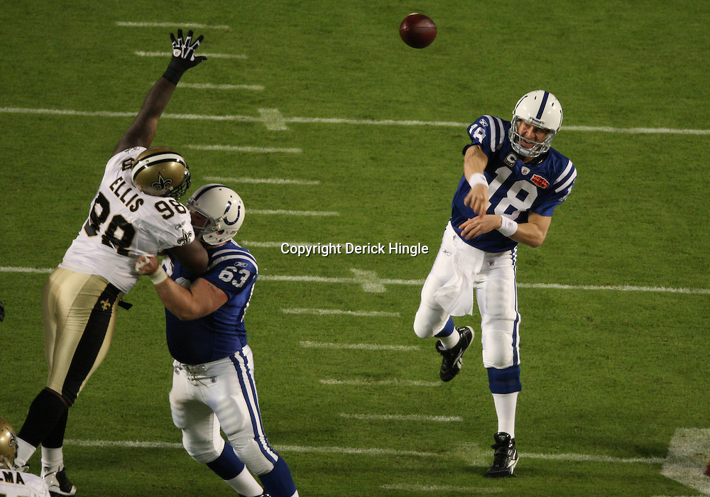 2010 February 07: Indianapolis Colts quarterback Peyton Manning (18) throws past New Orleans Saints defensive tackle Sedrick Ellis (98) during a 31-17 win by the New Orleans Saints over the Indianapolis Colts in Super Bowl XLIV at Sun Life Stadium in Miami Gardens, Florida.