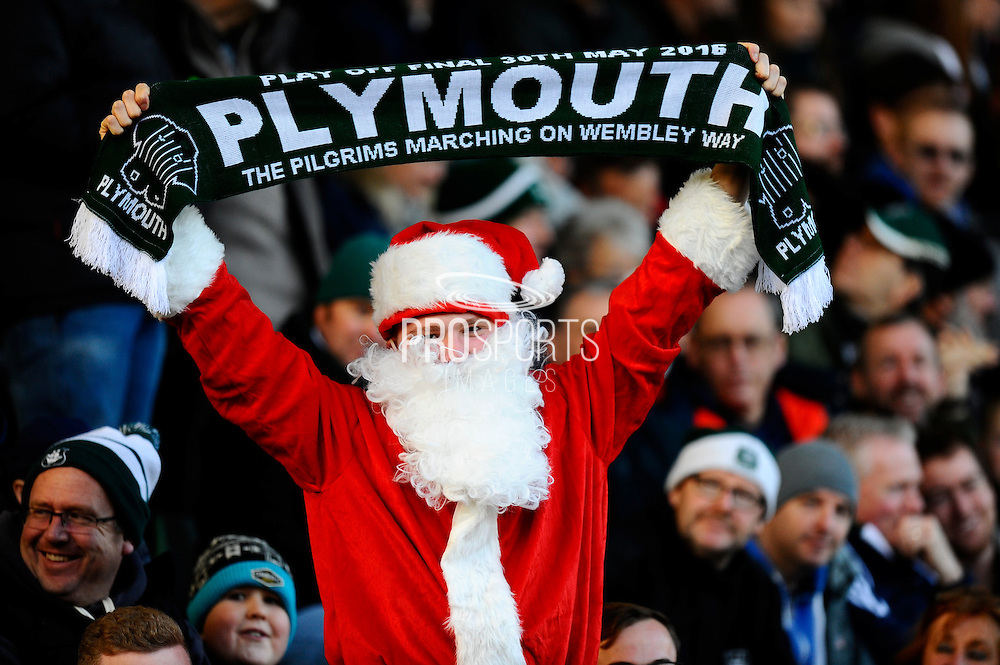 Plymouth fan dressed as Father Christmas with his scalf in the air before the EFL Sky Bet League 2 match between Plymouth Argyle and Wycombe Wanderers at Home Park, Plymouth, England on 26 December 2016. Photo by Graham Hunt.