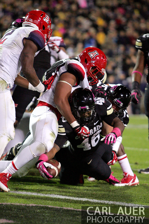 October 26th, 2013:  Colorado Buffaloes sophomore tail back Christian Powell (46) is stopped just short of the goal line in the third quarter of action in the NCAA football game between the University of Arizona Wildcats and the University of Colorado Buffaloes at Folsom Field in Boulder, Colorado