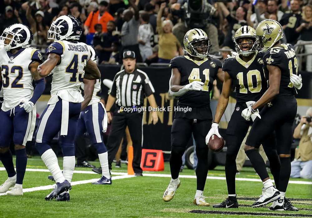 Nov 4, 2018; New Orleans, LA, USA; New Orleans Saints wide receiver Tre'Quan Smith (10) celebrates with running back Alvin Kamara (41) and wide receiver Michael Thomas (13) after a touchdown against the Los Angeles Rams during the first half at the Mercedes-Benz Superdome. Mandatory Credit: Derick E. Hingle-USA TODAY Sports