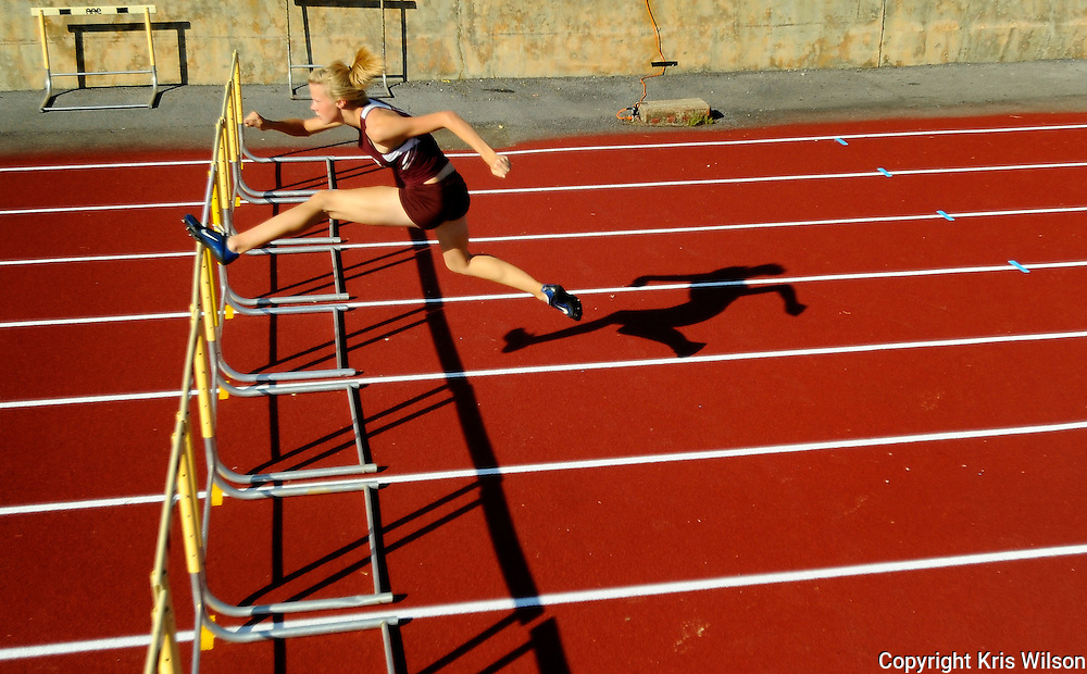 Tennessee High's Jennifer Cannon runs all alone while besting the field in the girls 100m hurdles at the 32nd Times-News Relays at Sullivan North.