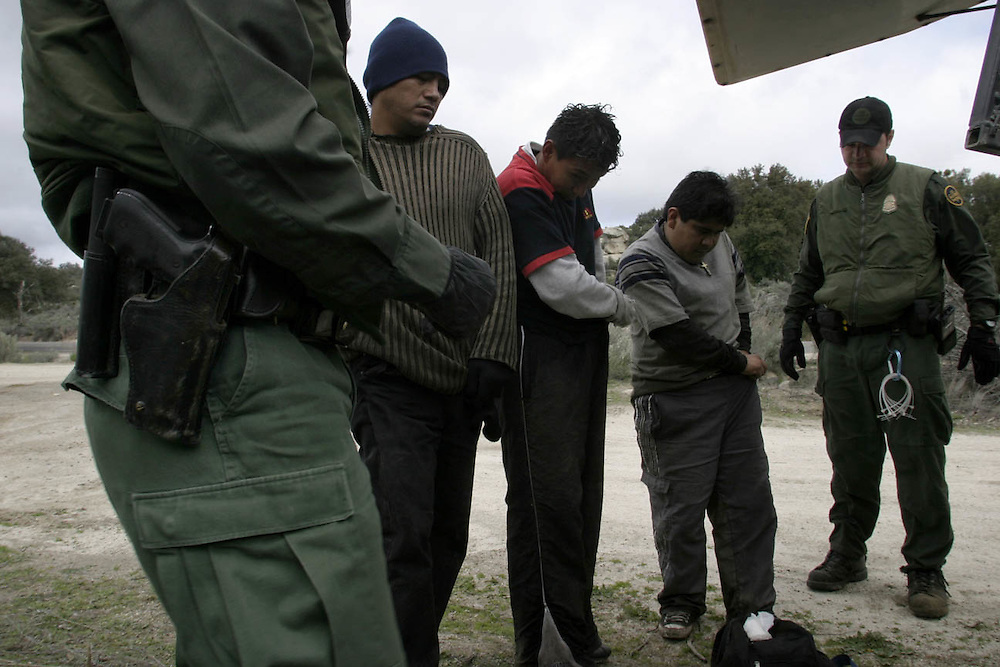 A U.S.A border patrol arrest undocumented immigrants that been watched by the minuteman members at the 21April 2006 next to Boulevard about 65 miles (104.6 km) east of downtown San Diego. At ......In the photo n the photo:..Raoll 28(with black hat and gloves) marriage +3 kids try to get to the USA to work in L.A....Yshmael 21 (T-Shirt with red sleeves)..Oskar (gray Shirt )..