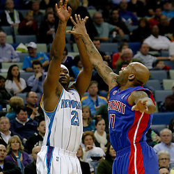 Dec 16, 2009; New Orleans, LA, USA;  New Orleans Hornets guard Devin Brown (23) shoots over Detroit Pistons guard Chucky Atkins (17) during the first half at the New Orleans Arena. Mandatory Credit: Derick E. Hingle-US PRESSWIRE