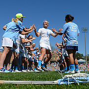 UNC midfielder Mallory Frysinger (1) high fives her teammates during playing introductions.