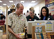 Christian Pearce, left, troubleshoots the checkout system at the Trader Joe's location on 400 South and 600 East, opening this Friday at 8:00am , Tuesday, Nov. 27, 2012.