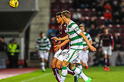 Celtic FC Defender Jozo Simunovic and Hearts FC Forward Osman Sow battle during the Scottish League Cup presented by Ulilita Energy quarter final match between Heart of Midlothian and Celtic at Tynecastle Stadium, Gorgie, Scotland on 28 October 2015. Photo by Craig McAllister.