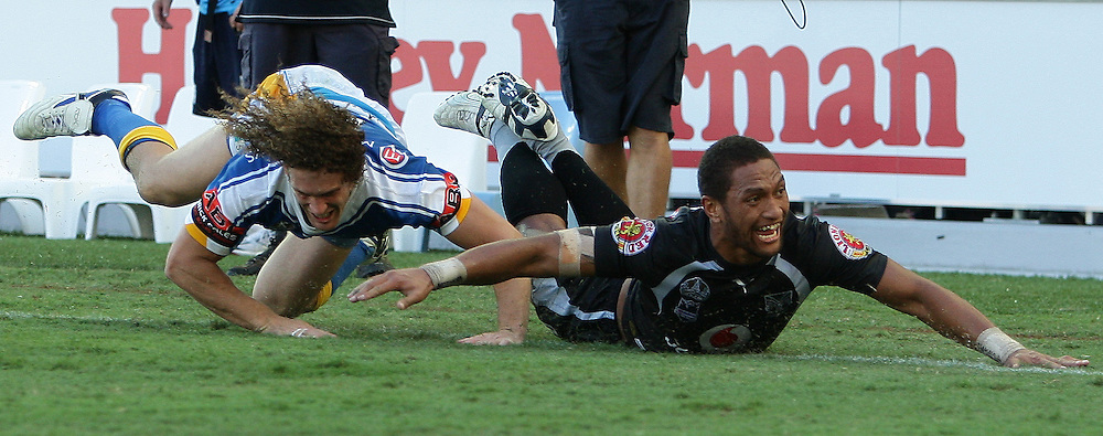 Manu Vatuvei celebrates a try to the Warriors during round 7 of the NRL - Gold Coast Titans v New Zealand Warriors. Played at Skilled Stadium, Robina QLD. Titans (36) defeated the Warriors (24).  Photo: Warren Keir (Photosport NZ).<br /> <br /> Use information: This image is intended for Editorial use only (e.g. news or commentary, print or electronic). Any commercial or promotional use requires additional clearance.