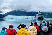 Tourists photograph Margerie Glacier as a cruise ship makes a turn in front of the face, in Glacier Bay National Park June 22, 2017. <br /> Photo by David Lienemann