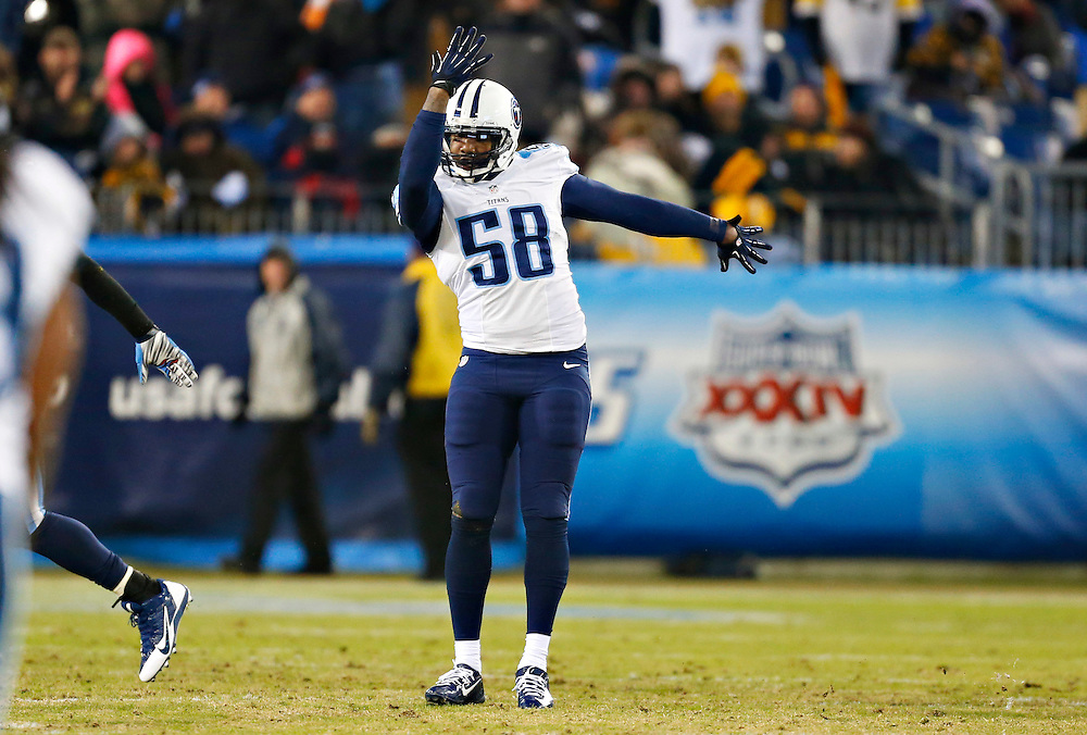 NASHVILLE, TN - NOVEMBER 17:  Shaun Phillips #58 of the Tennessee Titans celebrates after a sack during a game against the Pittsburgh Steelers at LP Field on November 17, 2014 in Nashville, Tennessee.  The Steelers defeated the Titans 27-24.  (Photo by Wesley Hitt/Getty Images) *** Local Caption *** Shaun Phillips