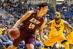 Dec 21, 2015; Morgantown, WV, USA; Eastern Kentucky Colonels forward Nick Mayo (10) dribbles while being guarded by West Virginia Mountaineers guard Jaysean Paige (5) during the first half at the WVU Coliseum. Mandatory Credit: Ben Queen-USA TODAY Sports