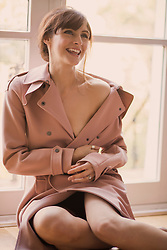 Portrait of Woman Wearing Pink Overcoat Smiling