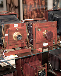 "Mahogany and brass cameras made for humid tropical climates are aesthetic pieces of engineering...<br /> <br /> November 18, 2011 - Philadelphia, PA; An impressive collection of more than 350 old cameras will be put up for auction on Saturday, Nov. 19, 2011 at Fuller's Fine Art Auctions in Philadelphia, PA.<br /> <br /> ( A selection of photos from this collection are published with the Nov 18, 2011 article by Alan Tu on WHYY's NewsWorks.org: ""Vintage cameras to be auctioned off Saturday by Mt. Airy auction house"" - You can read the article here: http://www.newsworks.org/index.php/local//mt-airychestnut-hill/30073-vintage-cameras-to-be-auctioned-off-saturday-by-mt-airy-auction-house )<br /> <br /> The cameras were collected by Edward Kaprelian (1913-1997), who after WWII became an expert on camera and lens technology. In May 1945, the U.S. Army seized more than 2,000 Carl Zeiss lenses from Germany as ""war reparations"" and turned them over to Kaprelian, who was then serving as Chief of the U.S. Army Signal Corps Engineering Labs in Fort Monmouth, N.J. <br /> <br /> Kaprelian went on to become an avid collector of photographic equipment and materials during his lifetime and amassed a large collection of important cameras spanning the history of photography."