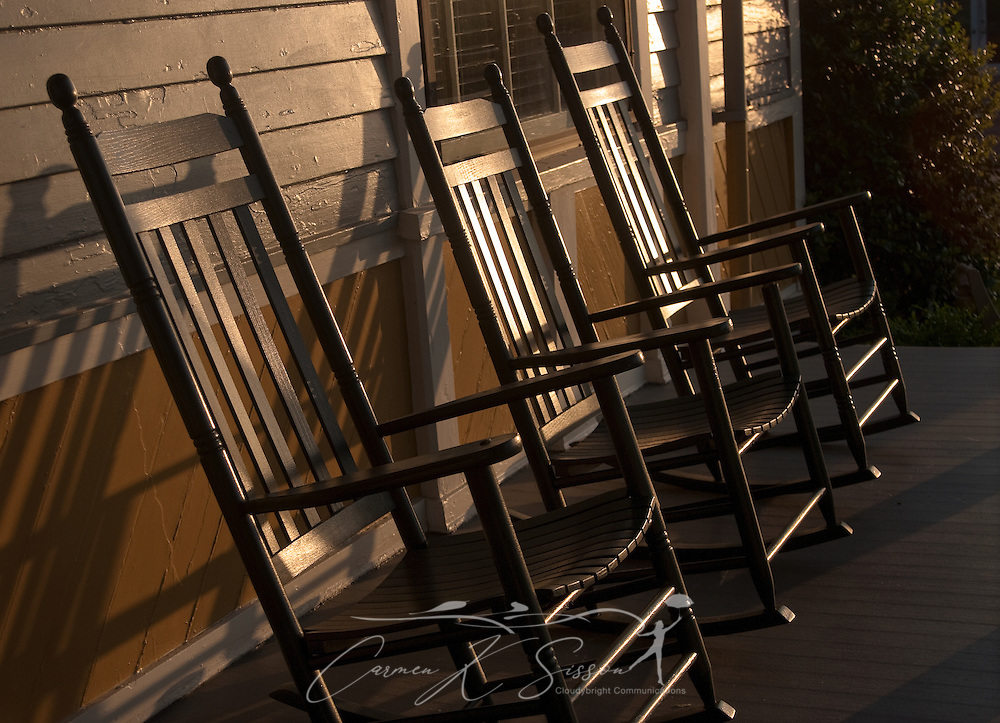 The sun sets on a trio of rocking chairs at Tennessee Williams Welcome Center in Columbus, Miss. The Welcome Center is located in the house where the Pulitzer Prize-winning playwright was born in 1911. (Photo by Carmen K. Sisson/Cloudybright)