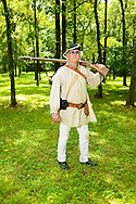 8/18/12 12:26:18 PM - Warwick, PA. -- Jim Ley of Langhorne, Pennsylvania shows how to use a rifle during a revolutionary war reenactment at the Moland House August 18, 2012 in Warwick, Pennsylvania. -- (Photo by William Thomas Cain/Cain Images)..