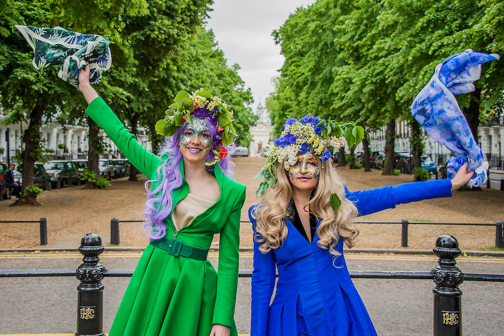 Catherine Walker & Co. staged a street display of its couture, in a series of theatrical, floral themed 'pop ups' to coincide with the RHS Chelsea Flower Show. Nine models walked along the Kings Road wearing evening dresses and tailoring from Catherine Walker & Co.s Spring Summer 2016 collection, which was inspired by the English country garden. Each model was adorned with elaborate, vibrant flower displays in their hair and extravagant, floral make-up.