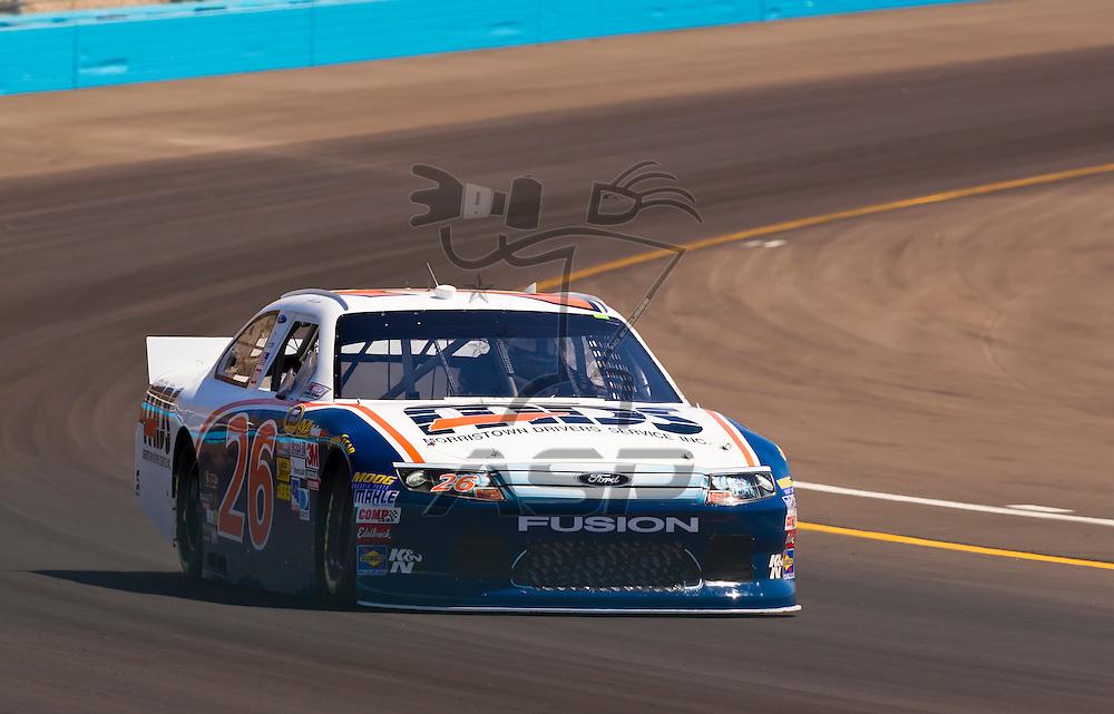 AVONDALE, AZ - MAR 03, 2012:  Josh Wise (26) brings his NASCAR Sprint Cup car through turn 4 during qualifying for the Subway Fresh Fit 500 race at the Phoenix International Raceway in Avondale, AZ.