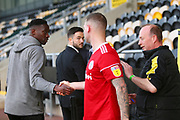 Burton Albion forward Lucas Akins (10) shakes the hand of Accrington Stanley forward Billy Kee (29) after the game, after breaking his all time goalscoring record during the EFL Sky Bet League 1 match between Burton Albion and Accrington Stanley at the Pirelli Stadium, Burton upon Trent, England on 23 March 2019.