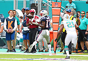 Sep 15, 2019; Miami Gardens, FL, USA;  New England Patriots wide receiver Antonio Brown (17) catches a pass from quarterback Tom Brady against the Miami Dolphins during an NFL game at Hard Rock Stadium in Miami Gardens, FL. The Patriots beat the Dolphins 43-0. (Steve Jacobson/Image of Sport)
