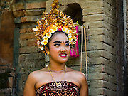 22 JULY 2016 - TENGANAN DUAH TUKAD, BALI, INDONESIA: Young women watch the pandanus fights in the Tenganan Duah Tukad village on Bali. The ritual Pandanus fights are dedicated to Hindu Lord Indra. Men engage in ritual combat with spiky pandanus leaves and rattan shields. They usually end up leaving bloody scratches on the combatants' backs. The young girls from the community wear their best outfits to watch the fights. The fights have been traced to traditional Balinese beliefs from the 14th century CE. The fights are annual events in the Balinese year, which is 210 days long, or about every seven months in the Gregorian calendar.    PHOTO BY JACK KURTZ