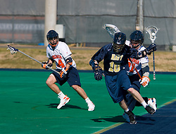 Navy attackman Gregory Clement (10) avoids Virginia Goalie Mark Wade (21).  The Virginia Cavaliers scrimmaged the Navy Midshipmen in lacrosse at the University Hall Turf Field  in Charlottesville, VA on February 2, 2008.
