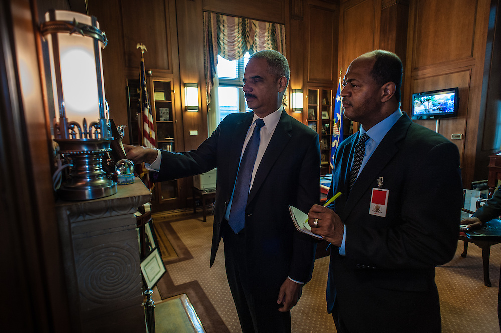 WASHINGTON, DC -- 6/3/14 -- Eric Holder stands with Ebony writer, Michael Cottman in his private office. U.S. Attorney General Eric Holder talks about Stand Your Ground, Fair Sentencing and felony disenfranchisement laws. Photos of him in the Attorney General's office and conference room.…by André Chung #AC1_6662