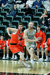 BLOOMINGTON, IL - December 15: Troy Howat and Colin Bonnett during a college basketball game between the IWU Titans  and the Carroll Pioneers on December 15 2018 at Shirk Center in Bloomington, IL. (Photo by Alan Look)