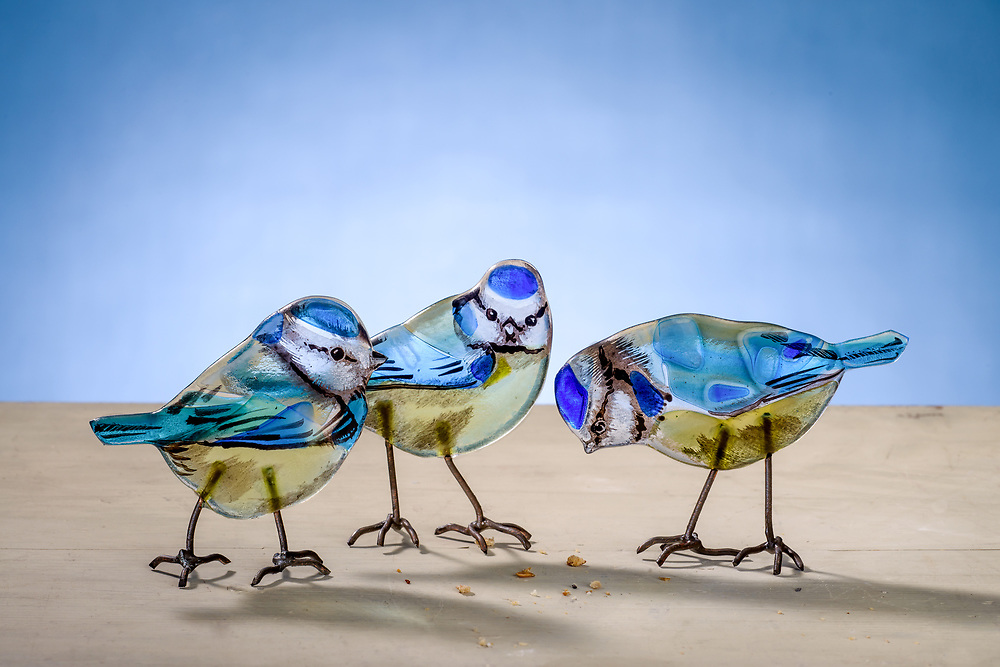 Handmade glass birds, Blue Tits by artist Emma Butler-Cole Aiken,  who is based in the Scottish Borders. <br />