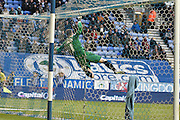 Bury Goalkeeper, Ian Lawlor is called into action again during the Sky Bet League 1 match between Wigan Athletic and Bury at the DW Stadium, Wigan, England on 27 February 2016. Photo by Mark Pollitt.