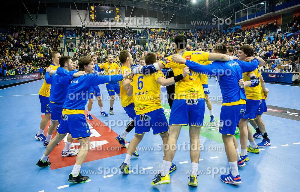 Players of Celje celebrate after winning the handball match between RK Celje Pivovarna Lasko and RK Croatia Osiguranje Zagreb in Round 7 of Group A of EHF Men's Champions League 2013/14, on November 30, 2013 in Arena Zlatorog, Celje, Slovenia. Photo by Vid Ponikvar / Sportida
