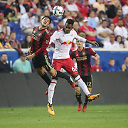 HARRISON, NEW JERSEY- OCTOBER 15: Yamil Asad #11 of Atlanta United challenged by Michael Murillo #62 of New York Red Bulls during the New York Red Bulls Vs Atlanta United FC, MLS regular season match at Red Bull Arena, Harrison, New Jersey on October 15, 2017 in Harrison, New Jersey. (Photo by Tim Clayton/Corbis via Getty Images)