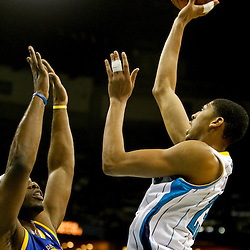 Jan 19, 2013; New Orleans, LA, USA; New Orleans Hornets power forward Anthony Davis (23) shoots over Golden State Warriors power forward Carl Landry (7) during  the first quarter of a game at the New Orleans Arena. Mandatory Credit: Derick E. Hingle-USA TODAY Sports