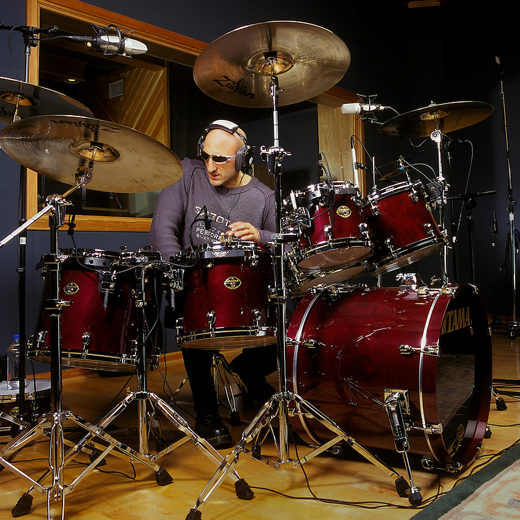 "Kenny Aronoff, world renowed drummer for his ""back-beat"", recording tracks in Studio.  Musicians like John Mellencamp, Smashing Pumpkins, Bob Seger, John Fogerty, Melissa Etheridge, Jon Bon Jovi, and Elton John, to name only a few, seek out Kenny's talent on the drums for their albums. The Aronoff Percussion Scholarship is awarded annually to a percussion student enrolled at Indiana University where he used to be an Associate Professor of Percussion."