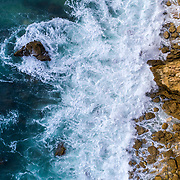 Aerial beautiful rocks and cliffs seascape shore view near Albufeira, Algarve, Portugal.