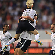 Abby Wambach, USA, celebrates her third goal with team mate Megan Rapinoe after becoming the greatest goal scorer in international soccer. Wambach scored four goals during the U.S. Women's 5-0 victory over Korea Republic, friendly soccer match. The four goals brings her tally to 160 goals which eclipsed Mia Hamm's all-time goal record of 158 goals.  Red Bull Arena, Harrison, New Jersey. USA. 20th June 2013. Photo Tim Clayton