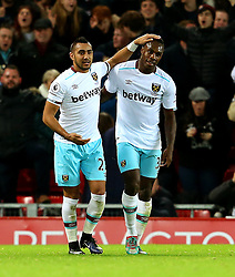 Michail Antonio of West Ham United celebrates with Dimitri Payet after scoring his sides second goal - Mandatory by-line: Matt McNulty/JMP - 11/12/2016 - FOOTBALL - Anfield - Liverpool, England - Liverpool v West Ham United - Premier League