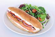Smoked Salmon sandwich served with salad
