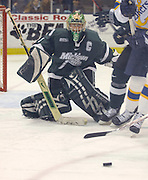 Michigan State goalie Jeff Lerg watches as team mates cover a shot rebound during the second period of the Spartans 4 to 2 loss to the Lake Superior State Lakers in Sault Ste. Marie.