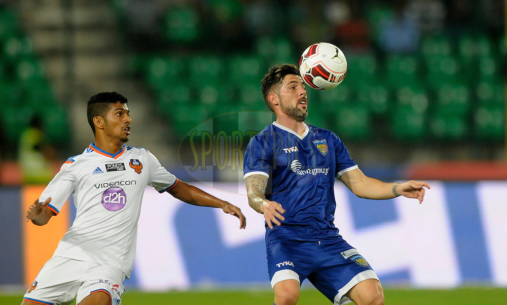 Cristian Hidalgo Gonzalez of Chennaiyin FC and Mandar Rao Dessai of FC Goa during match 50 of the Hero Indian Super League between Chennaiyin FC and FC Goa held at the Jawaharlal Nehru Stadium, Chennai, India on the 5th December 2014.<br /> <br /> Photo by:  Pal Pillai/ ISL/ SPORTZPICS