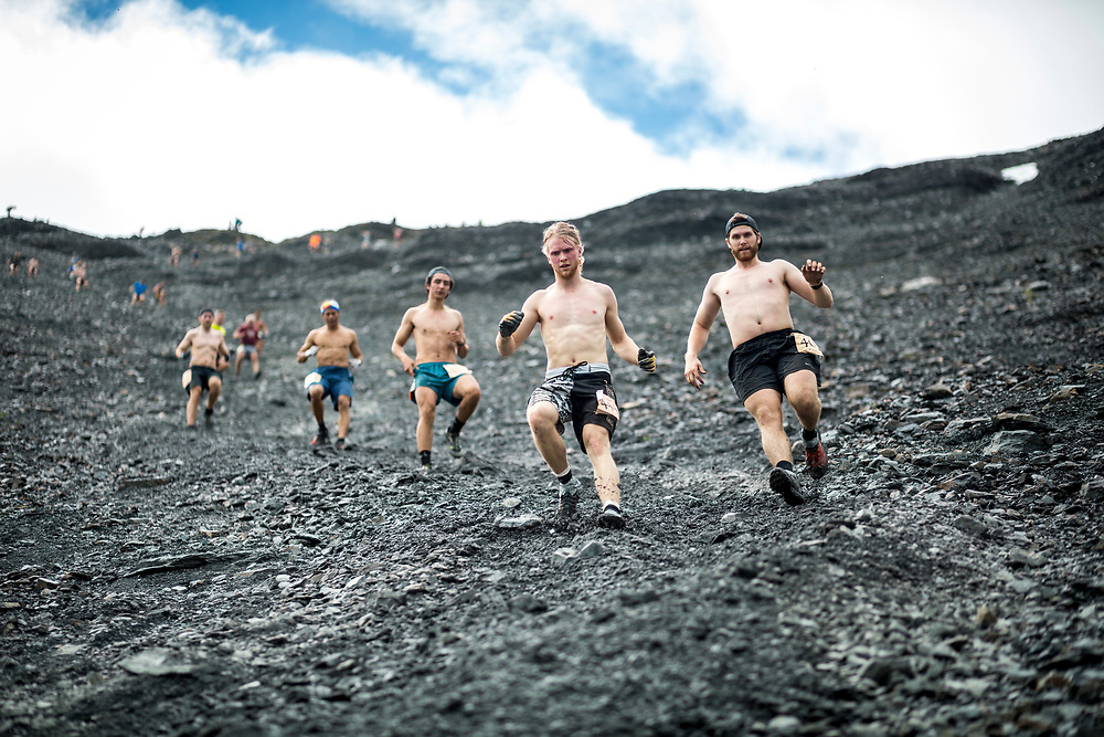 Runners stick to the soft, forgiving scree path while descending during the men's race.