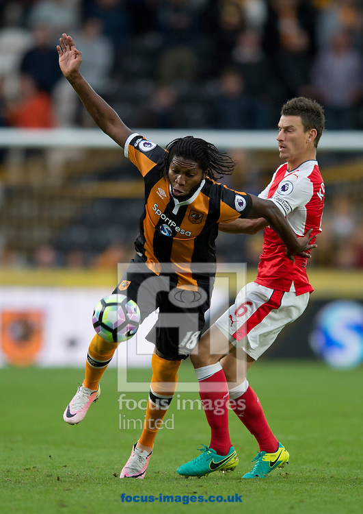 Dieumerci Mbokani of Hull City (left) and Laurent Koscielny of Arsenal challenge for the ball during the Premier League match at the KCOM Stadium, Hull<br /> Picture by Russell Hart/Focus Images Ltd 07791 688 420<br /> 17/09/2016