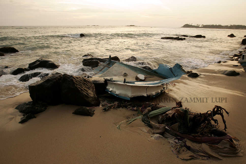 The remains of a boat on the beach near the tsunami-devastated area of Galle, south west coast of Sri Lanka, on January 13, 2005..Photo by Darrin Zammit Lupi