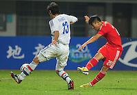 David Mendoza of Paraguay, left, tries to block a shot by Yu Hanchao of China during a friendly football match in Changsha city, central China's Hunan province, 14 October 2014.<br /> <br /> Paraguay's dismal run of form continued as they suffered a 2-1 friendly defeat to China on Tuesday (14 October 2014). The South American nation, who came into the game having won two of their previous 13 fixtures, fell short in their bid to pull off a late comeback at Changsha's Helong Stadium. In contrast to their opponents, China have now lost just two of their last 16 matches as they continue to build towards next year's AFC Asian Cup in Australia.