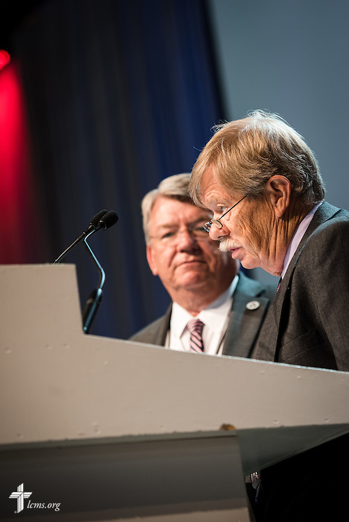 """The Rev. Dr. George Gude, chairman of the LCMS Commission on Constitutional Matters, speaks during Floor Committee 12 """"Ecclesiastical Supervision and Dispute Resolution"""" on Wednesday, July 13, 2016, at the 66th Regular Convention of The Lutheran Church–Missouri Synod, in Milwaukee. Next to him is the Rev. Dr. John Wille, president of the LCMS South Wisconsin District. LCMS/Michael Schuermann"""