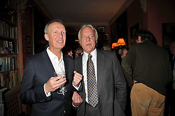 Left to right, ANTHONY BOURKE and JOHN RENDALL at a party to celebrate the publication of 'A Lion called Christian' held at 36 Chapel Street, London SW1 on 26th March 2009.