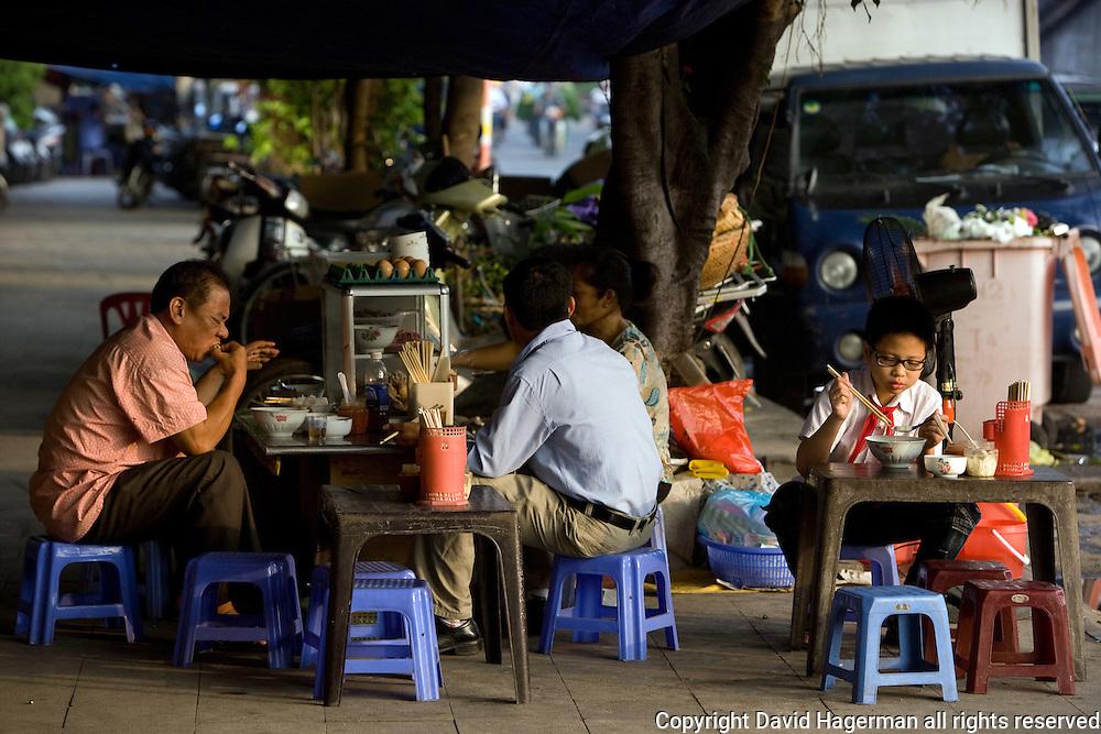 breakfast curbside in hanoi, vietnam
