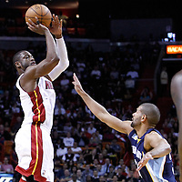 12 March 2011: Miami Heat shooting guard Dwyane Wade (3) takes a jumpshot over Memphis Grizzlies small forward Shane Battier (31) during the Miami Heat 118-85 victory over the Memphis Grizzlies at the AmericanAirlines Arena, Miami, Florida, USA. **