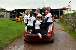 **EXCLUSIVE** ©  London News Pictures. 02/11/2013. Sam Cooke (Centre front), Organiser and girlfriend of Man U footballer Chris Smalling, with all the girls before the event preparing to view the course from the back of a car. Wives and girlfriends of Premiership football players do part of the famous Tough Guy event in Wolverhampton, UK. Mandatory photo credit : Mike King/LNP