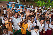 A group of children in their school playground, the mobile library is visiting organized by CLAP, Committee for Legal Aid to Poor (CLAP) is a non-profit organisation helping to provide legal aid to the poorer communities in the Orissa district of India.